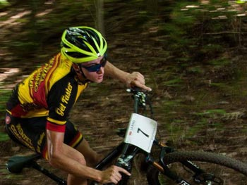 A Wenzel Coaching mountain bike rider takes a turn on the mtb