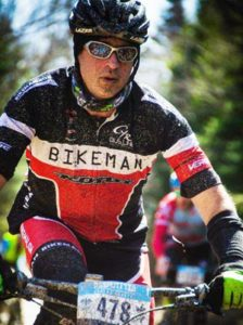 A Wenzel Coaching athlete concentrates during a mountain bike race.