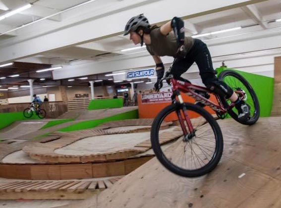 Coach Elaine Bothe demonstrates skills at the Lumberyard Bike Park