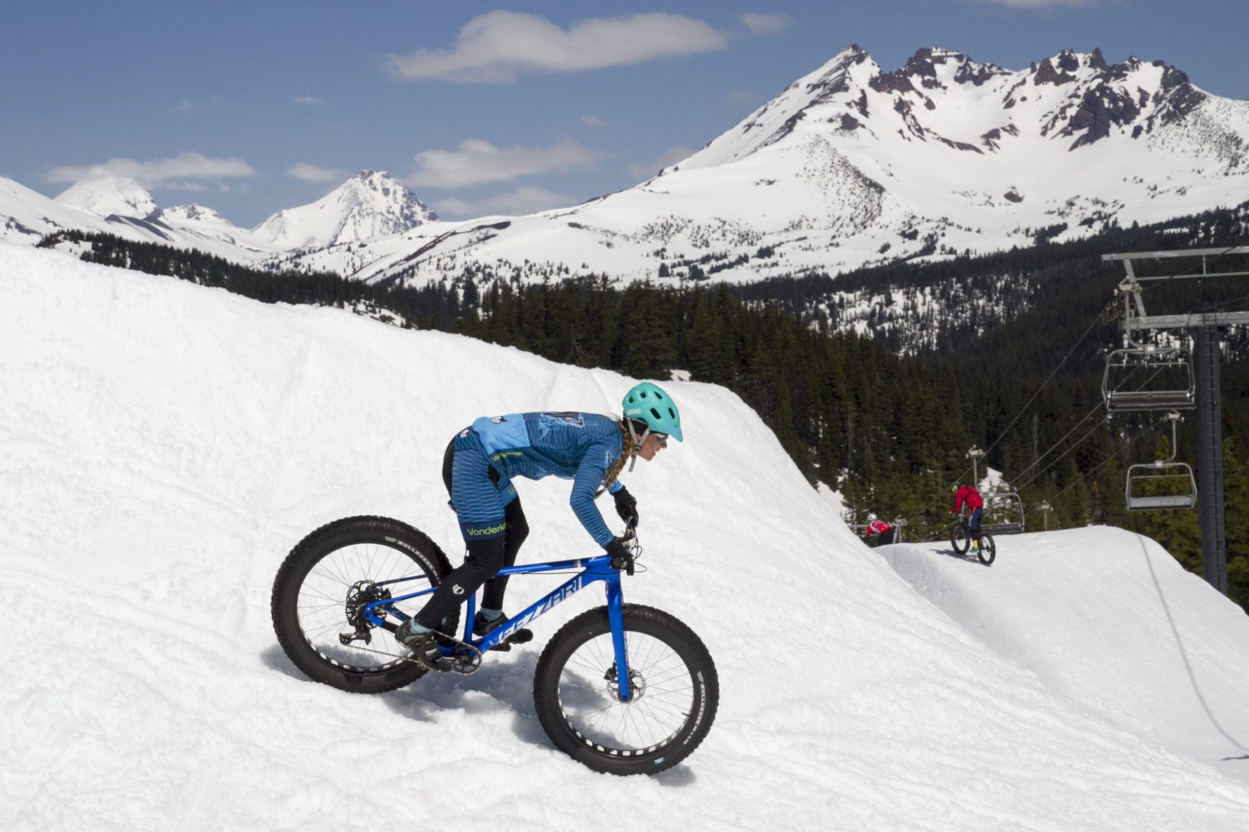 Emma Maaranen descends an alpine slope in the snow on her fat bike