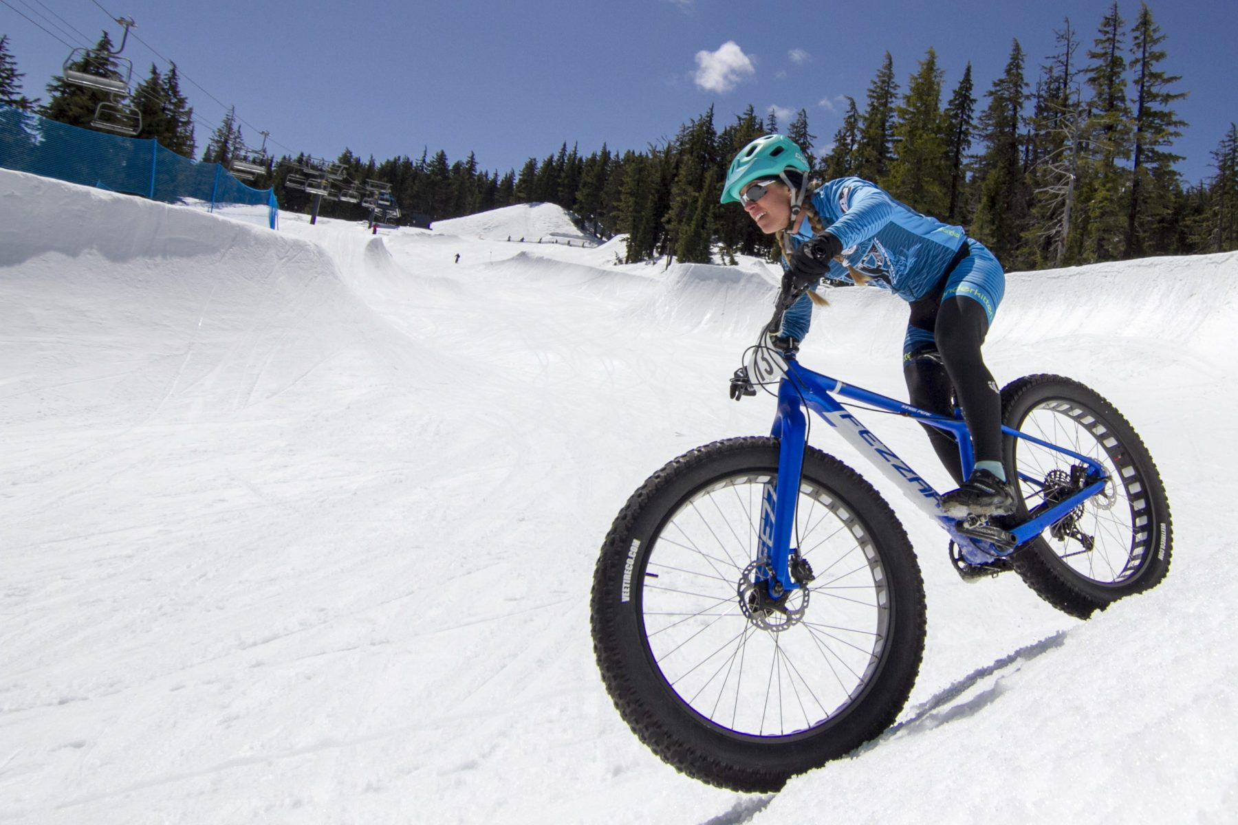 Wenzel Coach Emma Maaranen descends on a snow bike