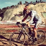 Coach Jeremy Russell rides during a cyclocross race