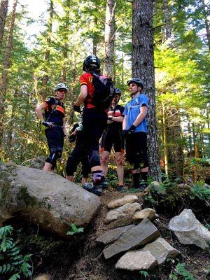 Associate Coach Elaine Bothe reviews a rock garden drill for the mountain bike