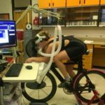 Wenzel Coach Leia Tyrrell performs a VO2Max test on a bike in a lab