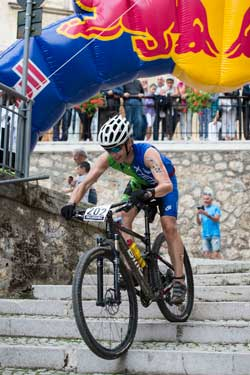 XTERRA Coach Rob Butner descends the stairs during an XTERRA event.