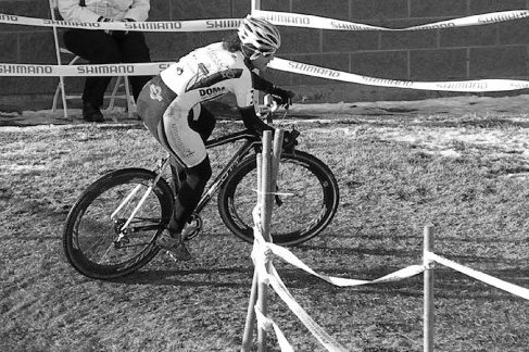 An athlete rides a corner at a USGP of Cyclocross.