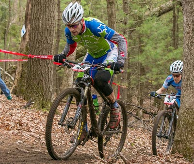Wenzel Coach and racer Aaron Oakes climbs a hill on the mountain bike