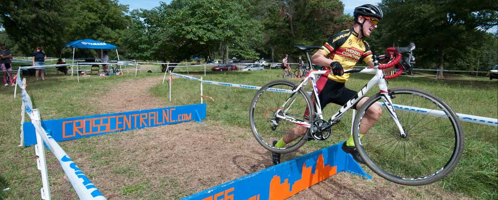 Wenzel Coaching Junior Development Team athlete Wheeler Davis strides over a barrier in a recent cyclocross race. Photo by Judy Miller.