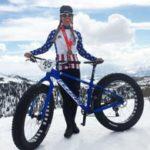 Coach Emma Maaranen poses next to her fat bike after winning the US National Fat Bike Championship