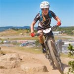 Coach Emma Maaranen corners on the mountain bike at the Sea Otter Classic