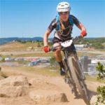 Coach Emma Maaranen corners on the mountain bike at the Sea Otter Classic