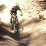 Coach Emma Maaranen descends down a chute on the mountain bike.