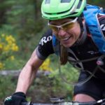Coach Emma Maaranen focuses and she presses ahead on the mountain bike.