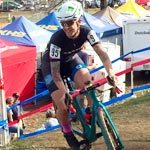 Wenzel Coach Jessica Cutler rides up a steep, short hill during a cyclocross race