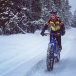 A Wenzel Coaching fat bike rider enjoys a snowy trail.