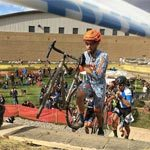 Wenzel Coach Jeremy Russell climbs the stairs at a Bend cyclocross race