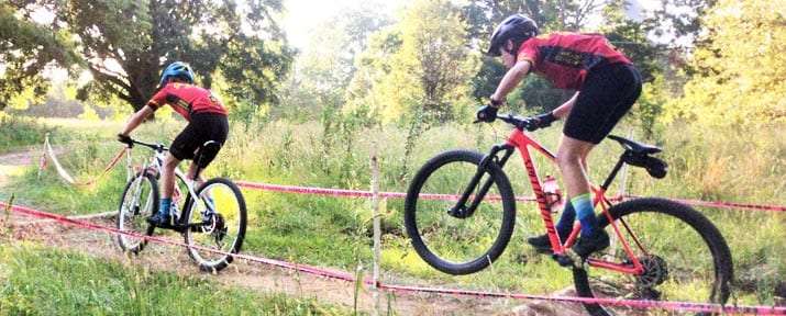 Wenzel Coaching Junior Development Team members ride together during a mountain bike race.