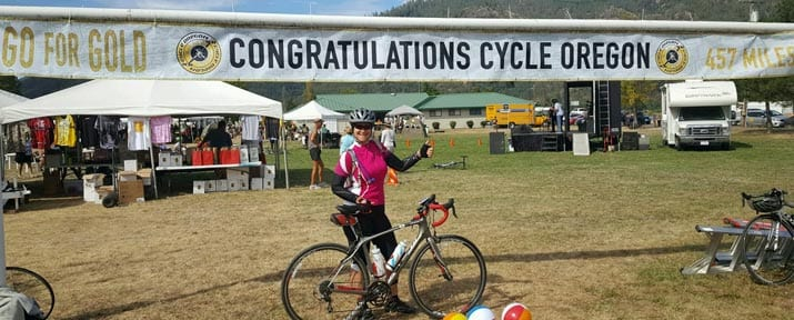 A rider gives the thumbs up at the finish of Cycle Oregon