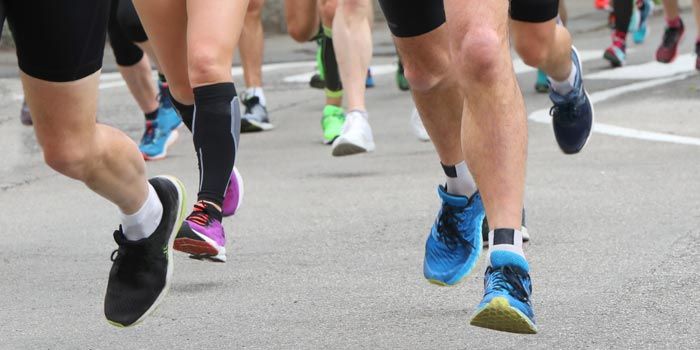 The legs of marathoners flash by during an event.