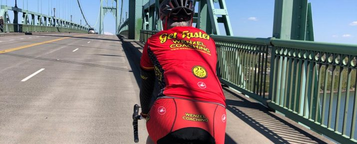 Head Coach Kendra Wenzel rides over the St John's Bridge in Portland OR during the COVID-19 empty roads.
