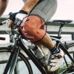 Close-up of cyclist's knee while riding bike