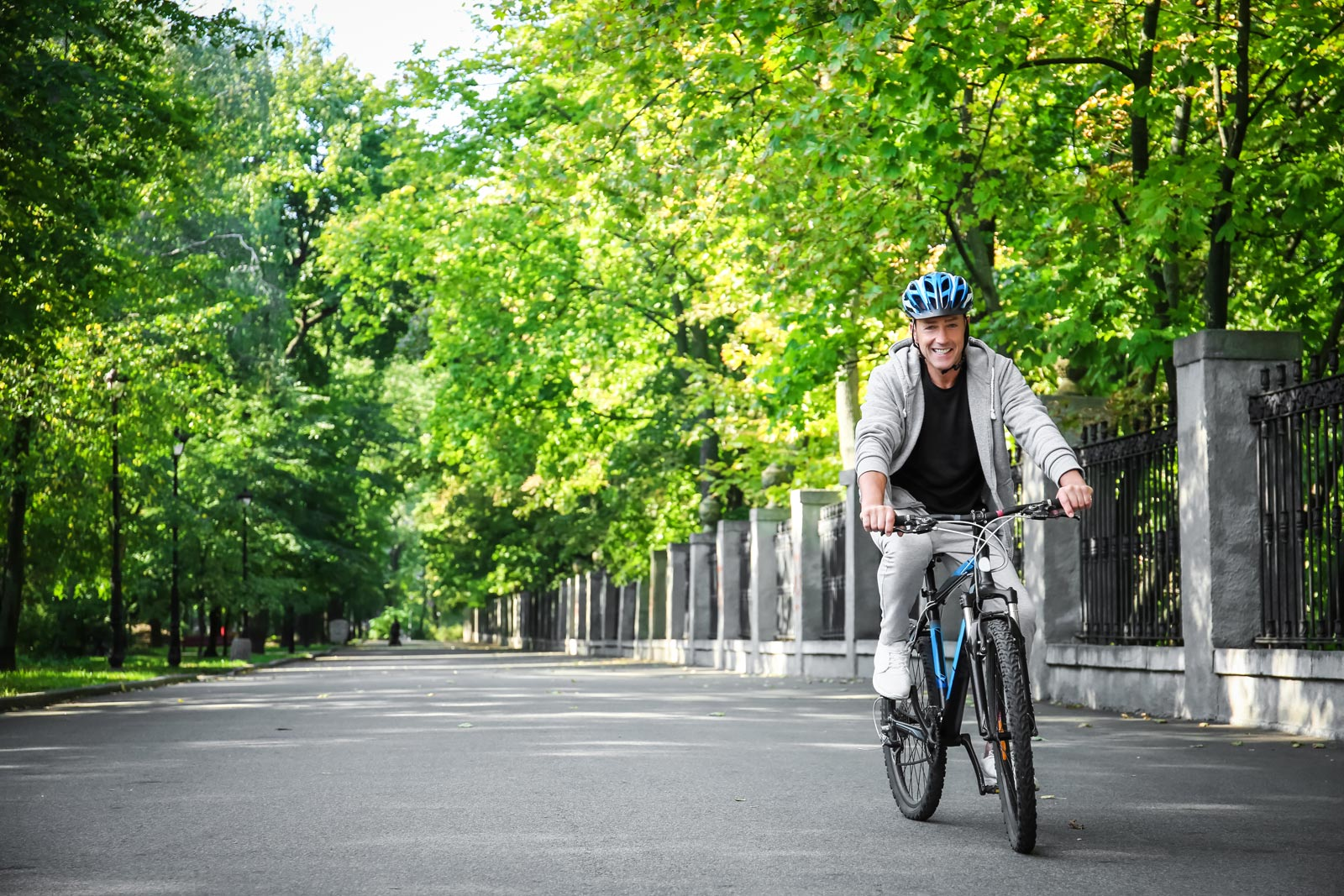 A man pedals on a bike path on a bicycle