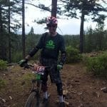 Wenzel Coach Chris Rudesill at the top of a climb on a mountain bike